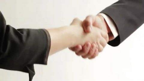 Businessman and businesswoman shaking hands Footage
