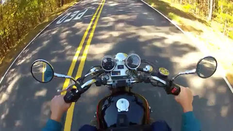 Handlebars gages and gas tank of a speeding motorcycle Live Action