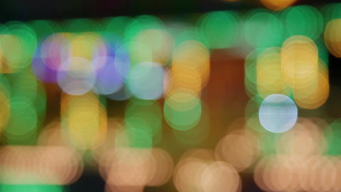 Color bokeh with light movement of the camera, colors change GIF