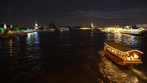 Big cruise boat with illuminated colorful lights sailing across the river at Footage