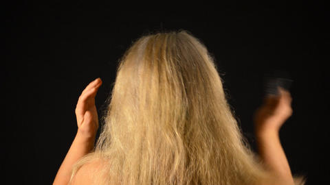 Blonde Woman Combs Her Dry Hair From The Back Footage
