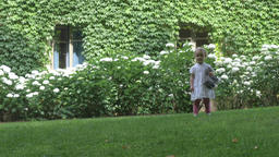 Child Running in Lush Backyard Live Action