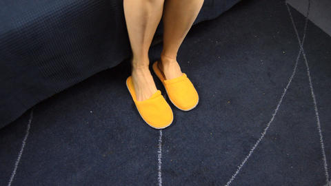 Woman Puts On Slippers On Dirty Carpet Footage