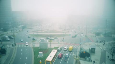 Aerial blurred shot of foggy city streets in Warsaw centre, Poland Photo