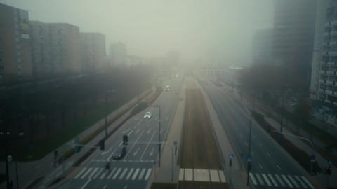 Flight over blurred city street in fog 영상물