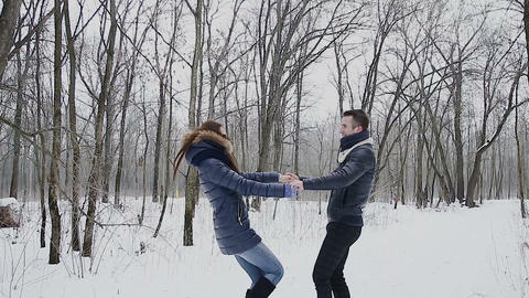 Guy and girl in winter in park Footage