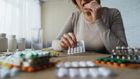 Addicted lady feeling good after drinking pills, illness symptoms, hypochondria Footage