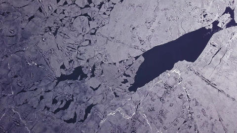Aerial view of detailed patterns of melting ice floes Live Action