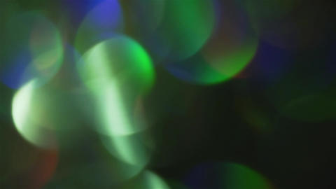 Natural shiny holographic light leaks on iridescent foil. Slow motion Footage
