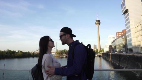 Happy Caucasian Couple Meet Kiss Hug, Rheinturm Rhine Tower, Dusseldorf Footage