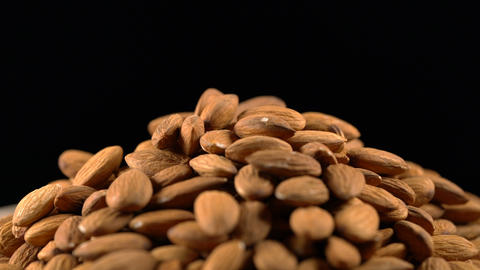 almond rotates on a black background Footage