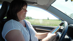 Woman is texting during driving a car Footage