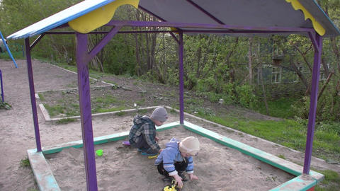children play in the sandbox Live Action
