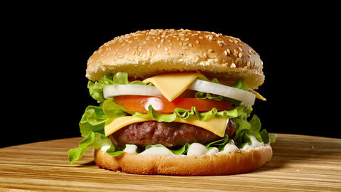 Closeup of home made beef burgers with lettuce and mayonnaise served on little Footage