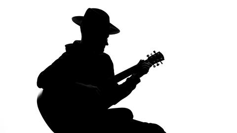 Musician silhouette singing and playing guitar at concert, art leisure, talent Footage