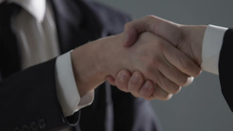 Business people shaking hands, official secretly giving money to corrupt lawyer Footage