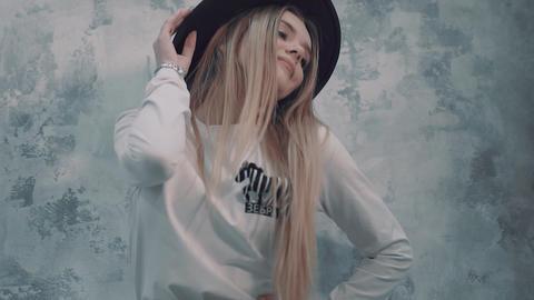 Girl model posing near the wall Footage