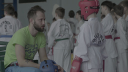 The coach and the boy-athlete during a competition in Taekwondo Footage