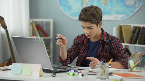 Boy successfully coping with homework, distance education for schoolchildren Live Action