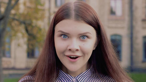 Emotional video-portrait of a beautiful girl talking wow Footage