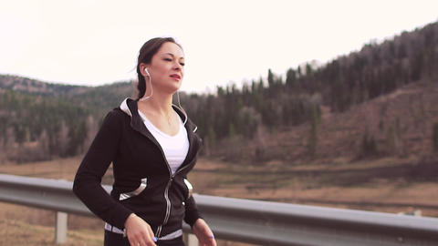 Running woman runner jogging on mountain road. Portrait of sport fitness girl Footage