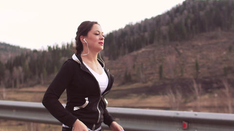 Running woman runner jogging on mountain road. Portrait... Stock Video Footage