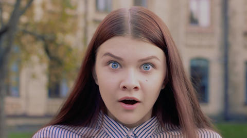 Emotional video-portrait of a surprised beautiful young girl Live Action