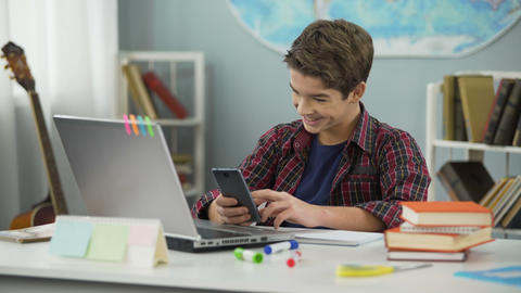 Boy enthusiastically chatting online with girl he likes, first love feelings Footage