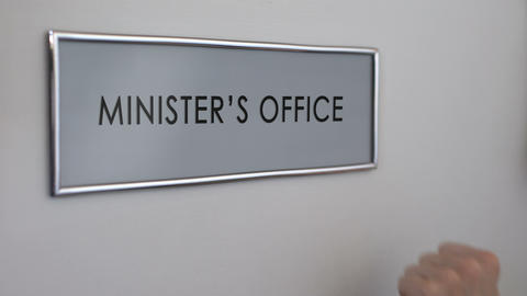 Minister office door, hand knocking closeup, government member, politician Live Action