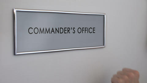 Commander office door, hand knocking closeup, company authority, leadership Live Action