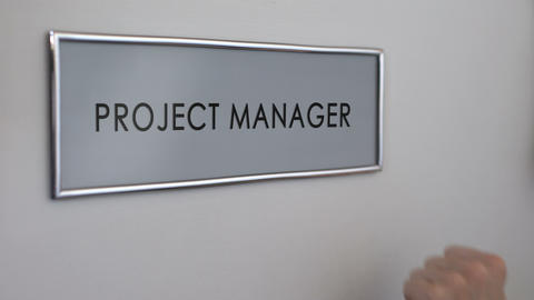 Project manager office door, hand knocking closeup, developing business strategy Live Action