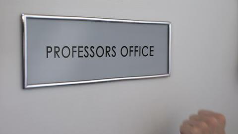 Professors office door, hand knocking closeup, university lecturers workplace Footage