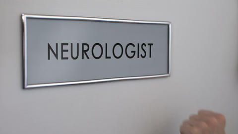 Neurologist room door, hand knocking closeup, nervous system disorder, reflex Footage