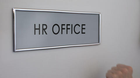 HR office door, hand knocking closeup, interviewing candidates, employment Live Action