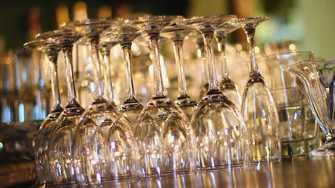 Row of transparent wine glasses standing on bar counter, luxury catering service Live Action