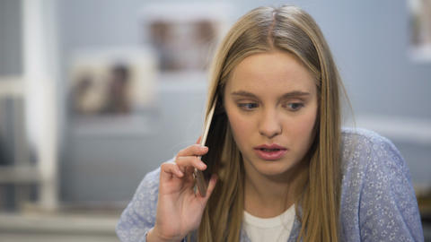 Student girl looking upset after phone talk with friend, date cancel, bad news Live Action