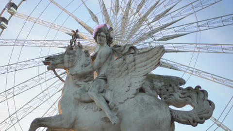 Lighting halo around Pegasus Equestrian statue from Big Wheel working behind Live Action