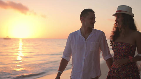 young loving couple on the seashore at dawn Stock Video Footage