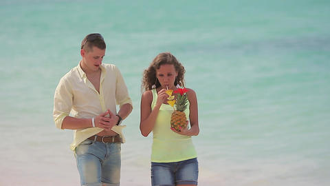 young couple walking on the beach Footage