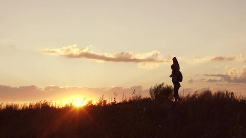 Father playing with little daughter at sunset. She sits on his shoulders Footage