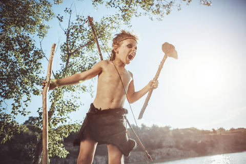 Caveman, manly boy with weapon Photo