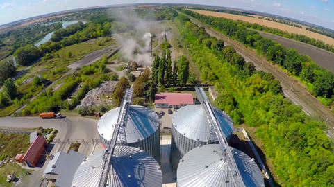Flight of the grain terminal from the drone. The grain plant for storage and Live Action