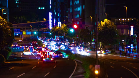 Night busy street at Aoyama avenue time lapse middle shot tilt down Footage