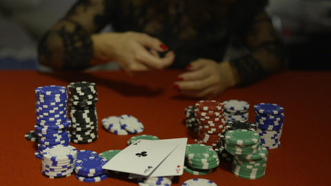 Woman showing aces pair and taking all poker chips, game winner Live Action