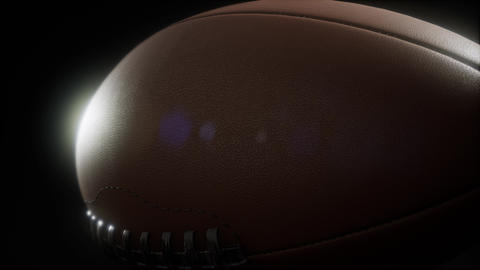 4K Super slow motion flying football on black background ビデオ