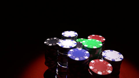 Close up of casino chips on red table surface GIF