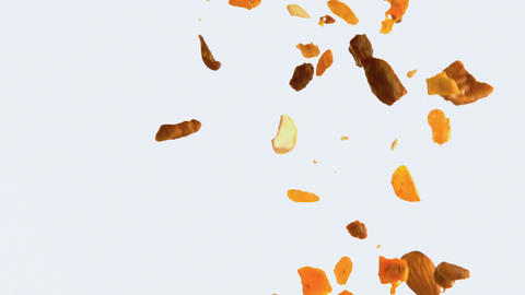 Dry fruits falling against white background 4k Live Action