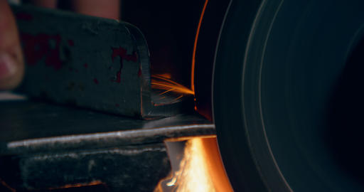 Worker shaping metal on machine in aircraft hangar 4k Live Action
