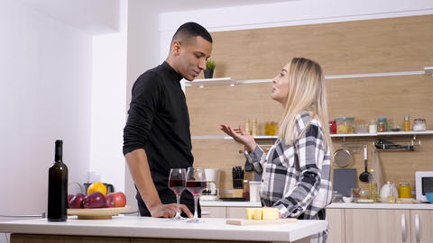 Interracial couple arguing at the kitchen Live Action