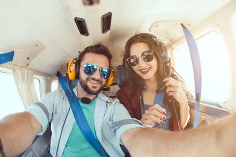 Young couple in airplane Photo